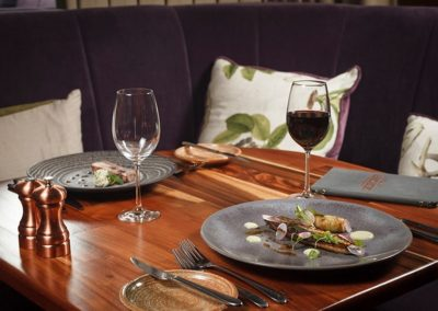 Suesey Street- Corner Table Booth in Dining Room with Food and Wine