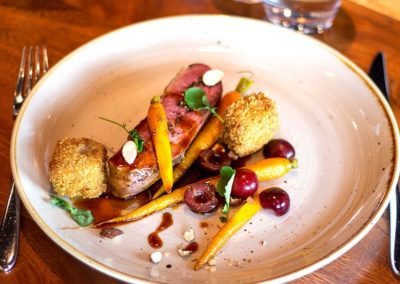 Suesey Street Seared Duck Breast with Crispy Leg Croquettes, Pickled Cherries, Smoked Almonds, Glazed Baby Carrots, Red Wine Jus