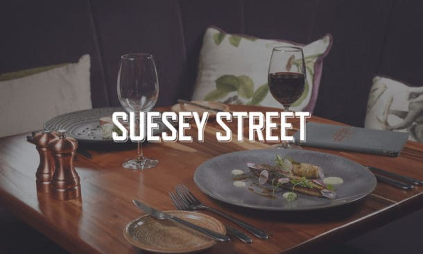 Suesey-Street-Table-Setting-with-Food-Wine-and-Salt