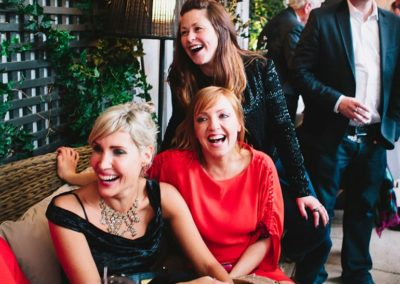 Suesey Street- Wedding Guests Laughing on Terrace