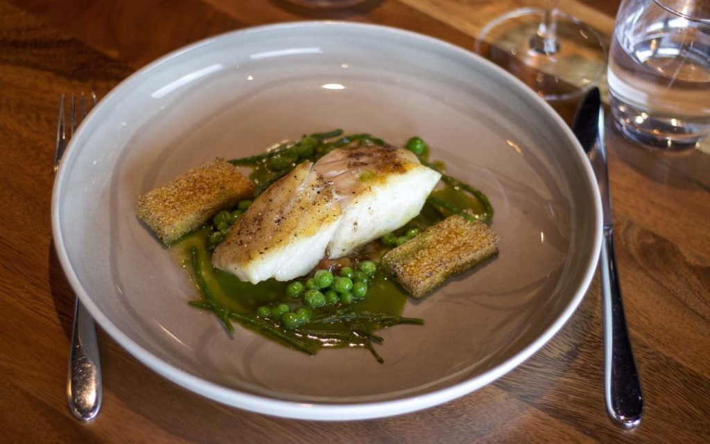 Pan Fried Fillet of Turbot with Fresh Peas Pea Jus Slow Cooked Tomato Compote Fried Polenta Pickled Samphire, Irish seafood