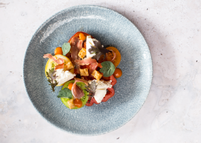 Suesey-Street--Burrata-and-tomato-salad,-with-smoked-tomato-and-lovage-emulsion,-croutons,-and-Connemara-airdried-ham-