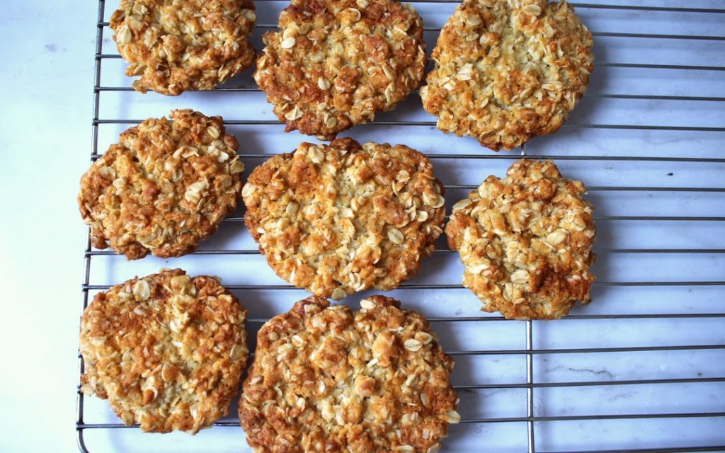 Anzac Cookies cooling on wire tray, Anzac biscuits